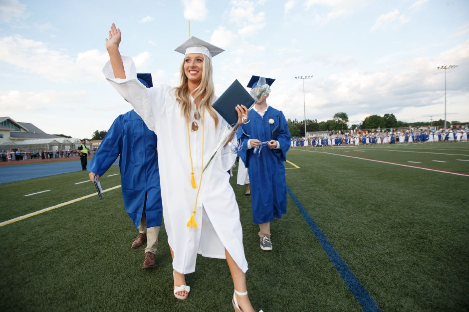 Graduates walk to the cap throw Thursday during Southington High School Graduation ceremonies at Southington High School in Southington June 21, 2018 | Justin Weekes / Special to the Record-Journal