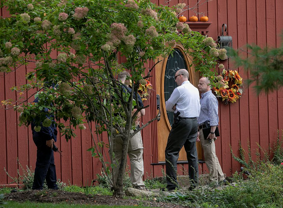 Investigators visit a home at 1272 Notch Rd. after a missing person was found dead near the intersection of Mixville and Marion roads in Cheshire, Thursday, Oct. 4, 2018. | Dave Zajac, Record-Journal