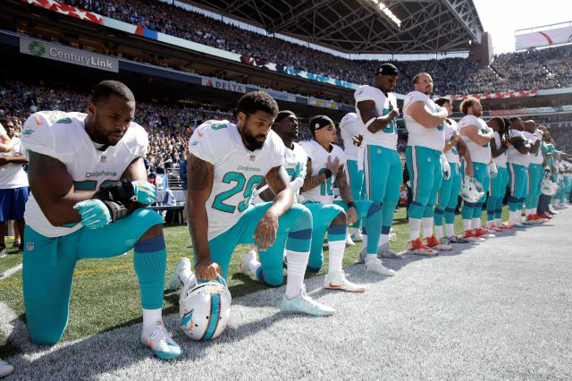 FILE - In this Sept. 11, 2017 file photo, from left, Miami Dolphins