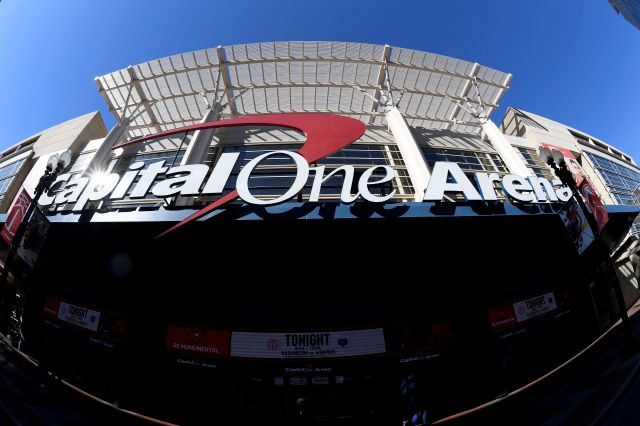 In this photograph taken with a fisheye lens, the exterior view of Capital One Arena is seen, Saturday, March 16, 2019, in Washington. As the NCAA prepares to stage its first basketball championships since the Supreme Court allowed legal sports betting in any state that wants it, the organization remains opposed to gambling on its events. But it's not denying reality, either. The NCAA had a longtime ban on bringing its championships to places where gambling on sports was legal. That was...