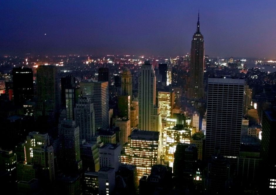 Twilight covers New York and the Empire State Building in this southern view from the 65th floor of the GE Building, after a massive blackout knocked out power Thursday, Aug. 14, 2003. Some buildings had backup generators to provide power. (AP Photo/Andrew Landis) ** SPECIAL RATES APPLY TO U.S NEWS MAGAZINES, FOR COMMERICAL RATES CALL WIDE WORLD PHOTOS AT 212-621-1930 **