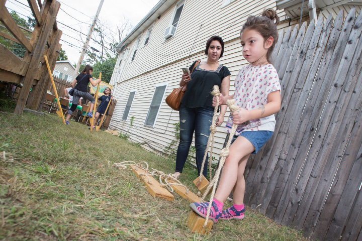Kameko Deak of Poughkeepsie NY watches her daughter Lyra Deak 5 try a set of kid stilts Sunday during the Hungarian Festival at the Hungarian Community Club in Wallingford Sep. 18, 2016 | Justin Weekes / For the Record-Journal