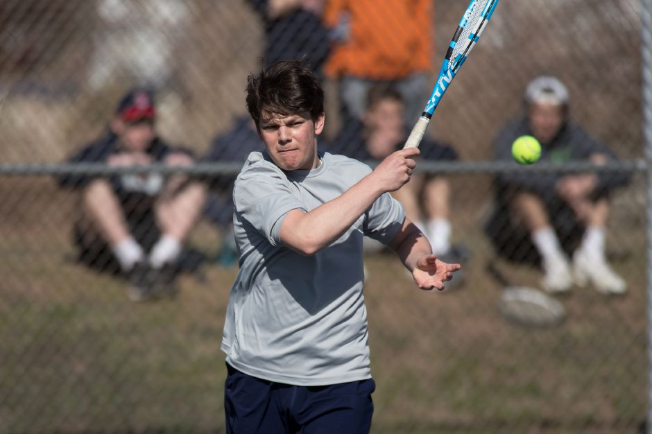 Yasha Laskin, Cheshire's No. 1 singles player, plays a forehand volley in his match against Lyman Hall's Corey Flynn on Thursday at Doolittle Park in Wallingford. Laskin prevailed, 6-1, 6-0, to lead the Rams to a 7-0 SCC sweep of the Trojans.