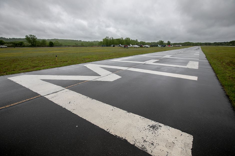 The taxiway at Meriden Markham Airport, Monday, May 22, 2017. Construction could begin in upcoming weeks on new taxilanes which will connect the main runway to 16 new hangars to be constructed in the grassy area, left, early next year. | Dave Zajac, Record-Journal
