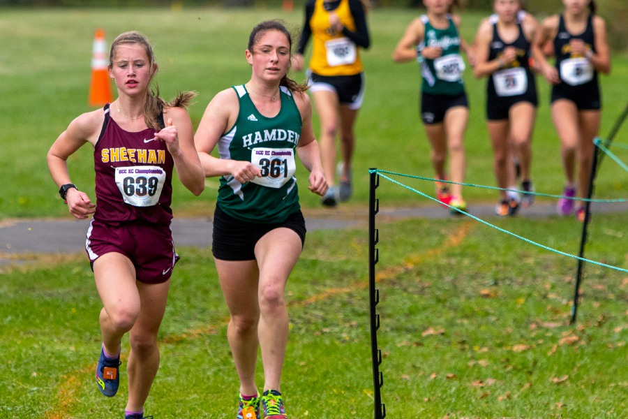 Sheehan's Liz Brown runs alongside Hamden's Ella Bradford early in the girls varsity race during Thursday's SCC Cross Country Championships at East Shore Park in New Haven. Bradford went on to win in 20 minutes flat. Brown finished second in 20:23.