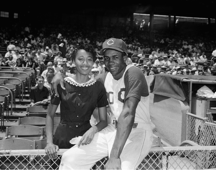 Frank Robinson sensational Rookie outfielder for the Cincinnati Reds is shown before the game July 16,1958 in Cincinnati with his fianc? Miss Viola Cobb.(AP Photo/GS)