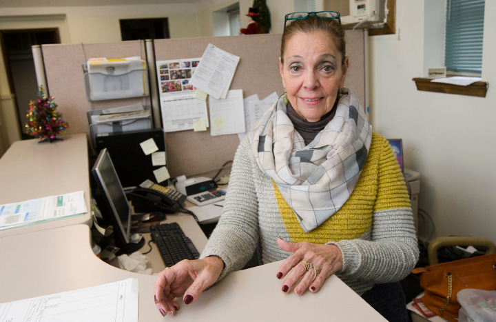 Jo-Ann Amantea, clerk III, poses at her desk at Meriden Parks and Recreation on Liberty Street, Wednesday, December 7, 2016. Amantea has been employed by the City of Meriden for more than 40 years.  | Dave Zajac, Record-Journal