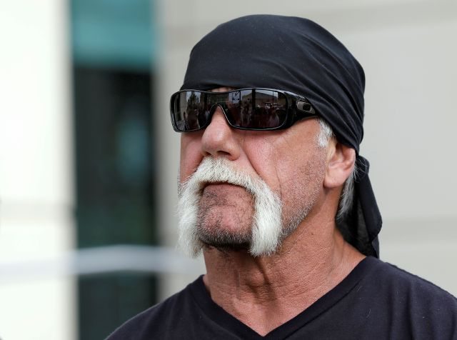 FILE - In this Oct. 15, 2012, file photo, reality TV star and former pro wrestler Hulk Hogan, whose real name is Terry Bollea, looks on as his attorney speaks in Tampa, Fla. World Wrestling Entertainment Inc. has reinstated Hogan to its Hall of Fame, three years after he was found to have used racial slurs in a conversation caught on a sex tape. (AP Photo/Chris O