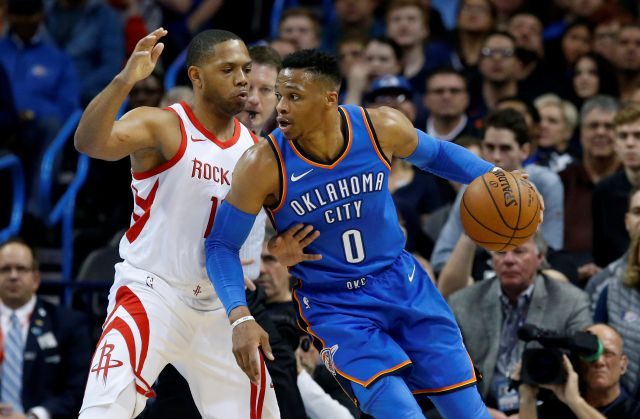 Oklahoma City Thunder guard Russell Westbrook (0) drives against Houston Rockets guard Eric Gordon, left, in the first half of an NBA basketball game in Oklahoma City, Tuesday, March 6, 2018. (AP Photo/Sue Ogrocki)
