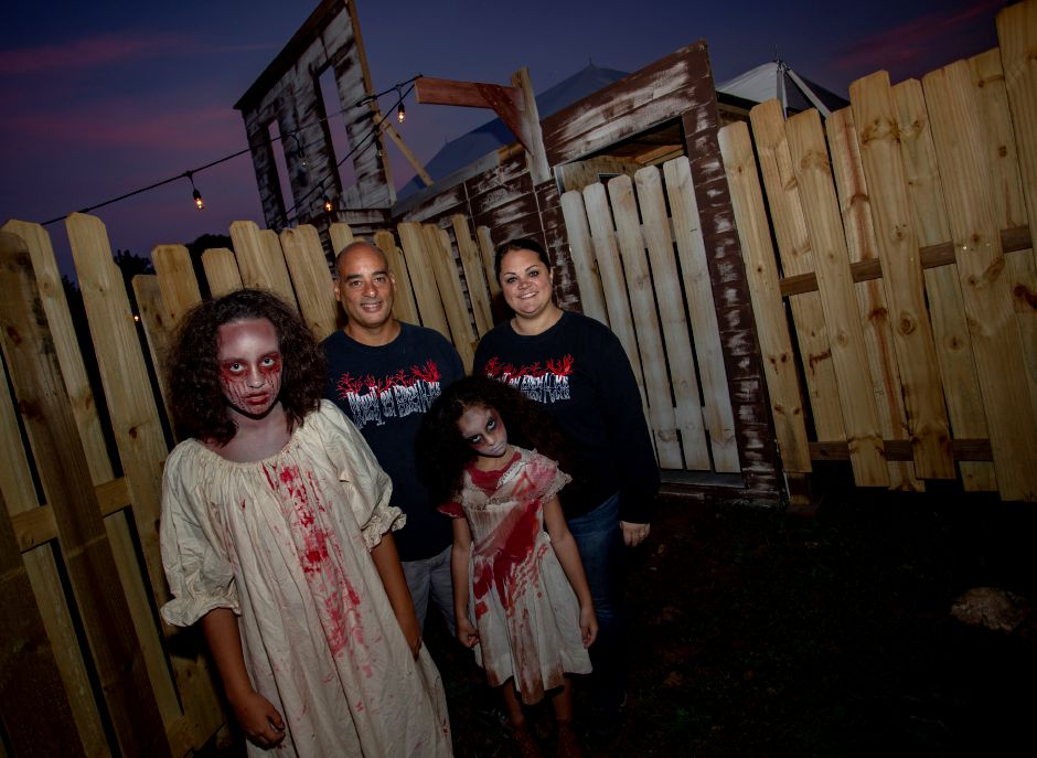 The Donis family, from left, Olivia, 13, Jeff, Amelia, 8, and Susan are the founders of the Haunt on Eden in Southington. | Richie Rathsack, Record-Journal