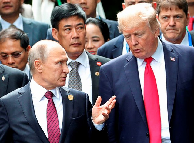 FILE - In this Nov. 11, 2017, file photo, U.S. President Donald Trump, right, and Russia