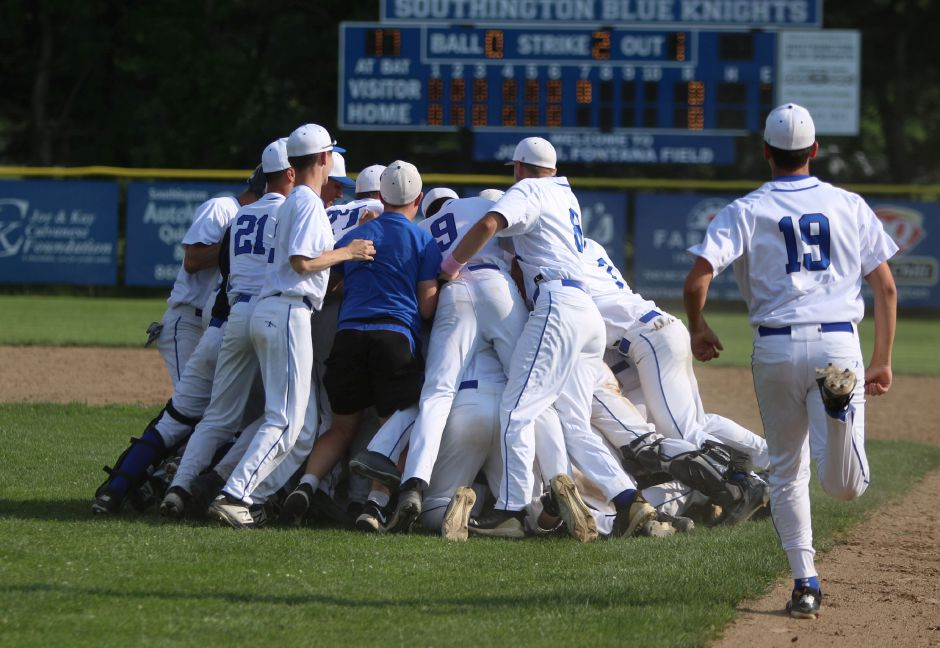 The Southington Blue Knights mob Billy Carr on Friday after the junior drove in the walk-off run for a second straight day, this time to beat Darien 1-0 in the second round of the Class LL state tournament.