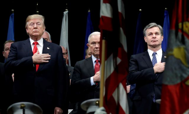 "President Donald Trump, Attorney General Jeff Sessions, center and FBI Director Christopher Wray stand during the National Anthem at the FBI National Academy graduation ceremony, Friday, Dec. 15, 2017, in Quantico, Va. The White House says newly revealed FBI records show there is ""extreme bias"" against President Donald Trump among senior leadership at the FBI. The accusation came hours before Trump was scheduled to speak Friday at the FBI training academy. (AP Photo/Evan Vucci)"