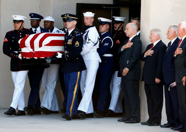 A military honor guard walks with the casket of Sen. John McCain, R-Ariz., after a memorial service at North Phoenix Baptist Church Thursday, Aug. 30, 2018, in Phoenix. (AP Photo/Ross D. Franklin)