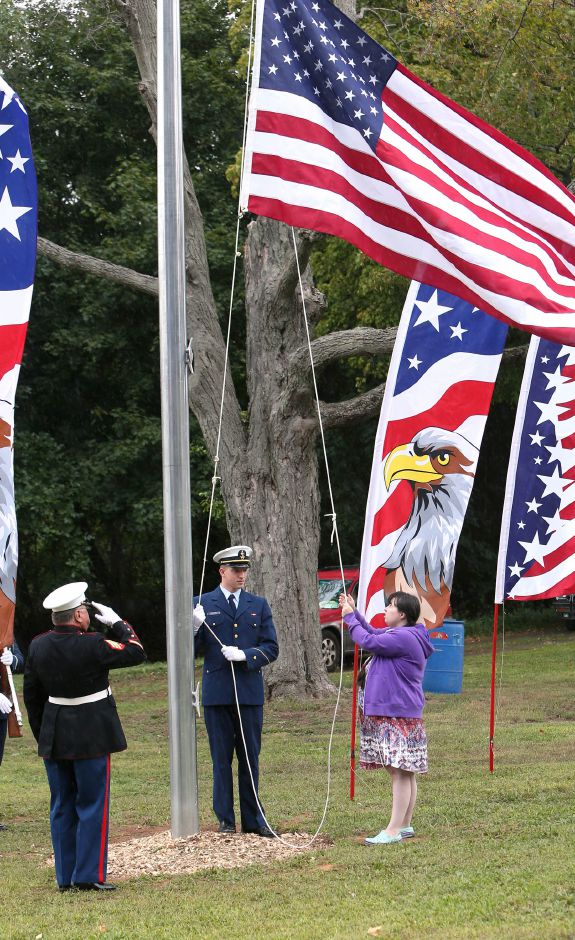 Morgan Morenz, of Meriden, raises the flag during the celebration of the American Legion's 100th anniversary at the annual American Legion Post 45 All American Picnic in Meriden on Saturday, Sept. 14, 2019. Morenz has raised more than $1,000 for Post 45 through the sales of her artwork. Emily J. Tilley, special to the Record-Journal.
