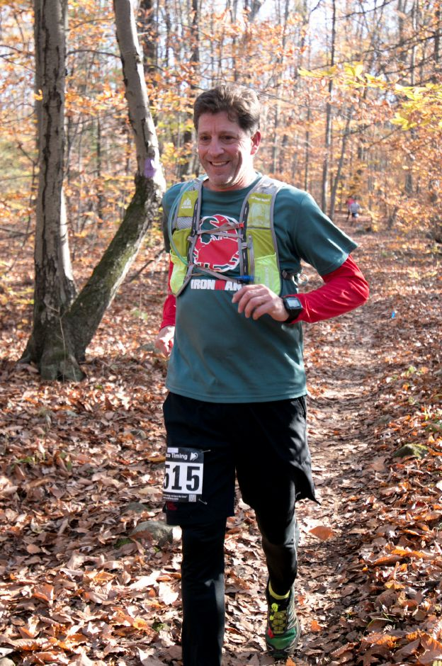 Robert Geary runs through the trails around the Southington YMCA