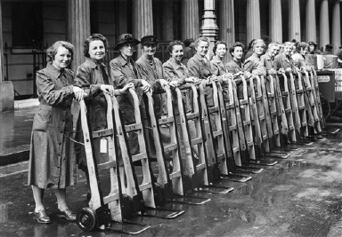 Members of the Women's Voluntary Services of London are ready for their first assignments with their porters' barrows purchased from money given by the readers of the Toronto Evening Telegram in Canada, August 30, 1942. The W. V. S. also purchased food tricycles and vans for transporting clothing and food to bombed areas by means of the gift. (AP Photo)