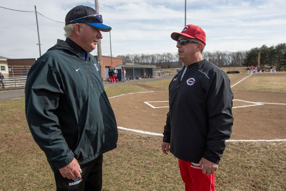 Southington head coach Charlie Lembo, left, welcomes Cheshire's new head coach Mike Lussier prior to Monday's scrimmage at Southington High School. Lussier, a long-time assistant, takes over for Bill Mrowka, who stepped down last summer after the Rams won the Class LL state championship. | Justin Weekes / Special to the Record-Journal