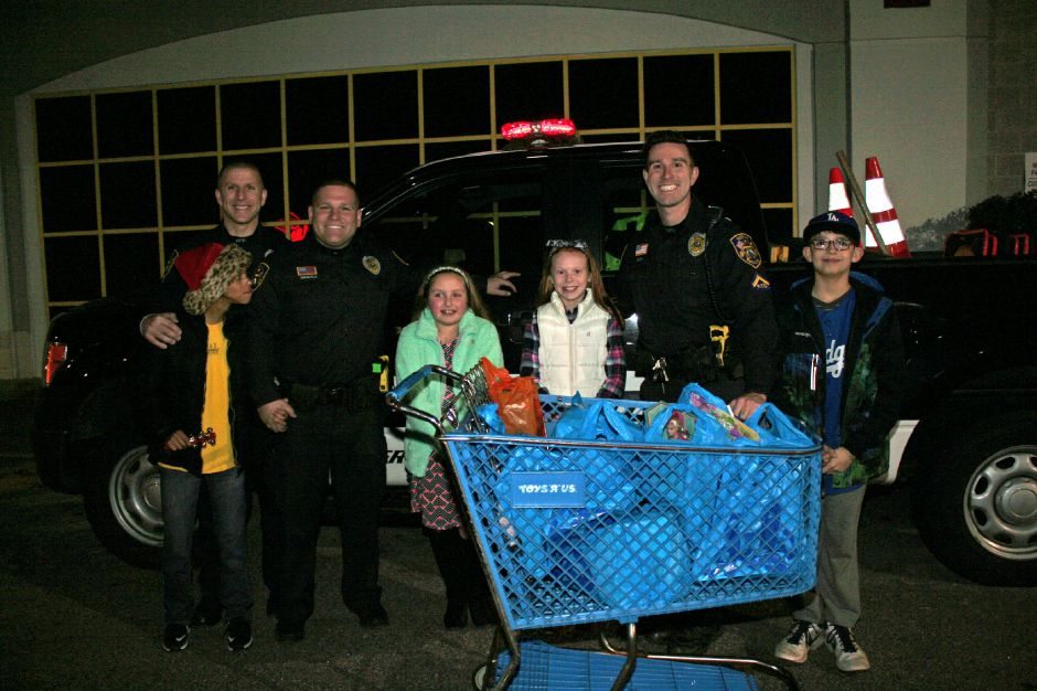 Berlin police and Berlin students shop for families in need for the holiday season. Photos taken in 2016. |Courtesy of Berlin PD