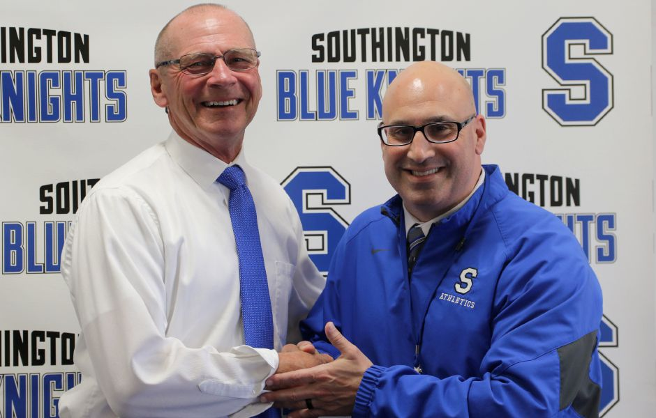 Former Maloney boys basketball head coach Howie Hewett, left, is introduced as Southington