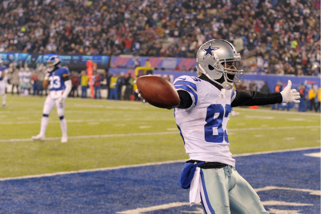 Dallas Cowboys wide receiver Terrance Williams (83) celebrates after scoring a touchdown during the first half of an NFL football game against the New York Giants Sunday, Dec. 11, 2016, in East Rutherford, N.J. (AP Photo/Bill Kostroun)