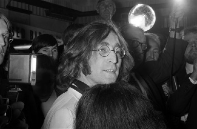 John Lennon arrives at the premiere of the new Beatles cartoon film Yellow Submarine at the London Pavillion Cinema, England on July 17, 1968. (AP Photo/Peter Kemp)