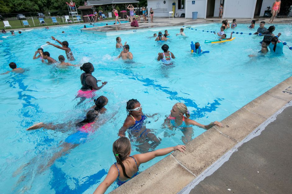 Children with diabetes and other campers take to the pool during a pilot diabetes day camp at the YMCA's Mountain Mist Outdoor Center in Meriden, Thurs., Aug. 8, 2019. The camp is run in conjunction with the Children's Medical Center in Hartford, the Y, and funded through the Lion's Club. Dave Zajac, Record-Journal