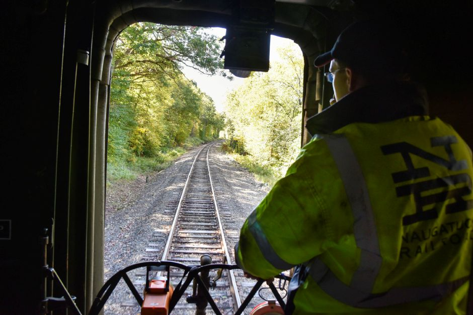 Conductor Matthew Sniffen relays messages to the engineer during a Naugatuck Railroad ride in Thomaston on Saturday, Oct. 5, 2019. The train included a stop at a private pumpkin patch. | Bailey Wright, Record-Journal