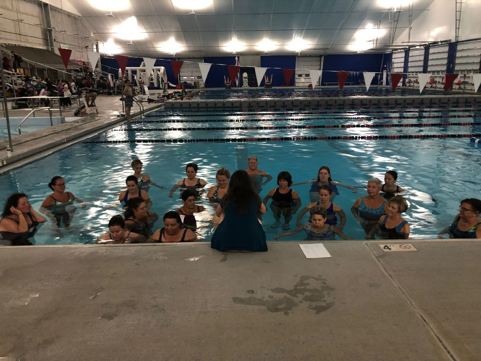 Cammuso begins the class with a meditation at the Cheshire Community Pool. |Kristen Dearborn, Special to Record-Journal