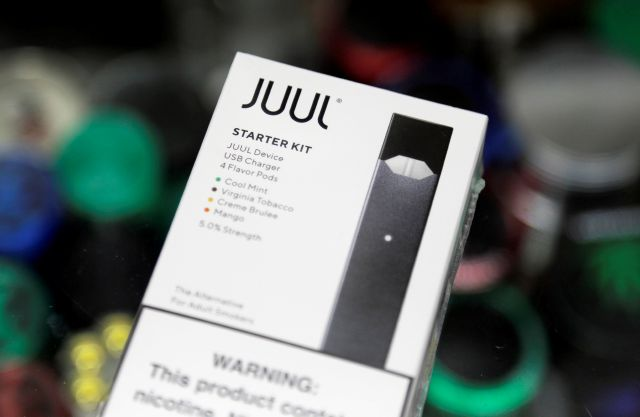 FILE - This Dec. 20, 2018, file photo shows a Juul electronic cigarette starter kit at a smoke shop in New York. Juul is the largest U.S. seller of electronic cigarettes, controlling about 70% of the market. (AP Photo/Seth Wenig)