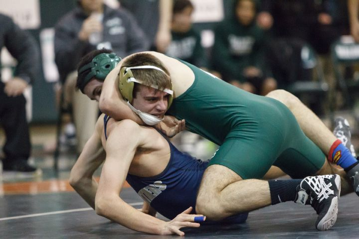 Maloney's Ahmed Abdelghani has a hold off Platt's Devyn McCarty in the 145-pound weight class. | Justin Weekes / For the Record-Journal