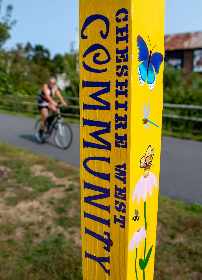 A cyclist rides along the Farmington Canal Heritage Trail in Cheshire as he passes the Cheshire West Community Butterfly Gardens on Tuesday, September 15, 2020. Aaron Flaum, Record-Journal