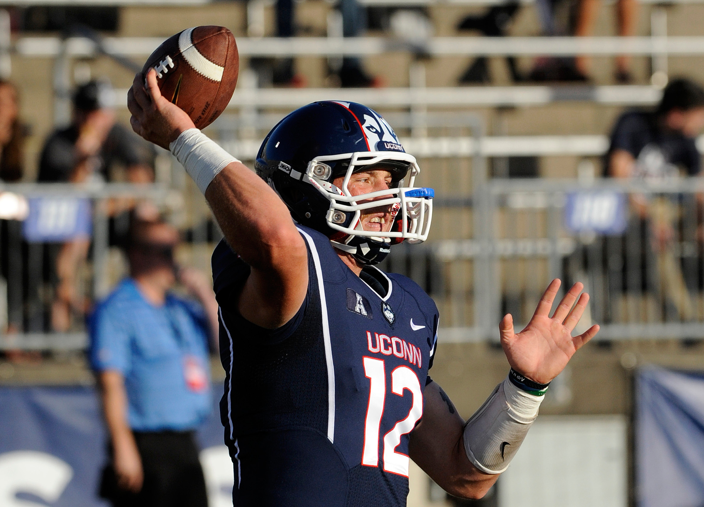 UConn quarterback Casey Cochran warms up before and August 2014 game against BYU at Rentschler Field. During the game, Cochran suffered the 13th concussion of his playing career. It was the one that prompted him to leave football. | File photo, Associated Press