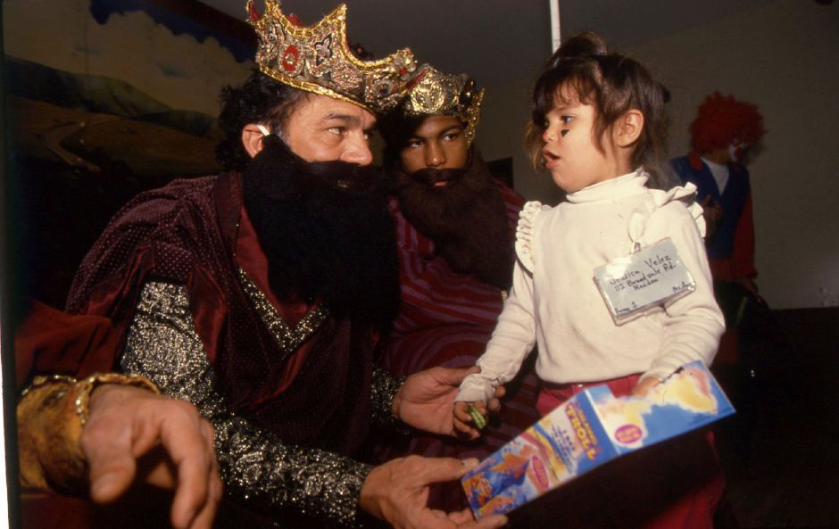 RJ file photo - Jessica Velez, 3, receives a present during Three Kings Day at the Latin American Social Club in Meriden Jan. 6, 1994.
