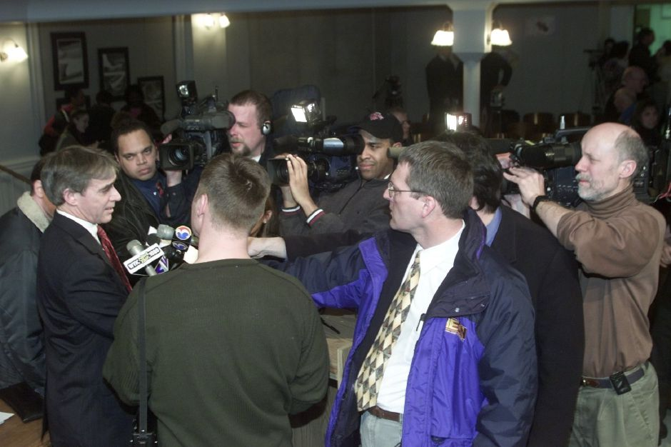 Broadcast and radio journalists mob mayor William Dickinson after the Martin Luther King Day clebration at Wallingford Town Hall on Monday Jan. 15, 2001.