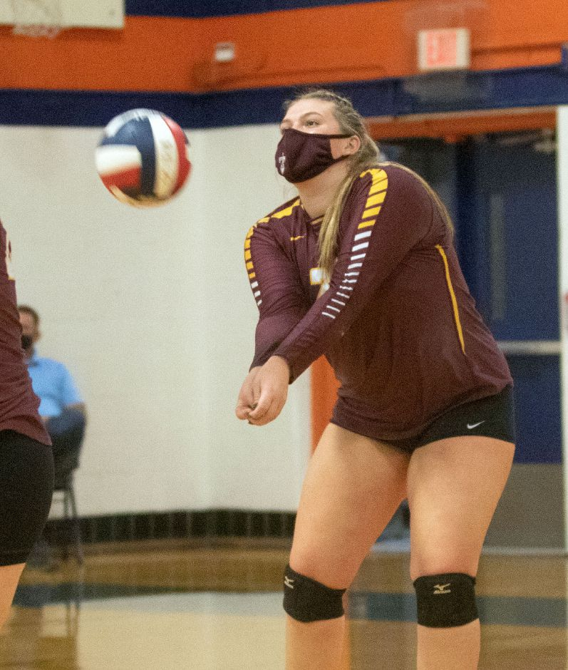 Sheehan's Caitlyn Hunt bumps a serve from Lyman Hall during a match-up at Lyman Hall on Thursday, October 15, 2020. Aaron Flaum, Record-Journal