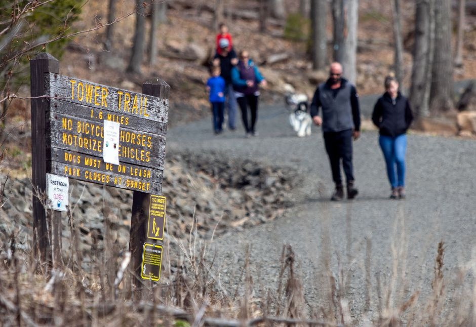 Hikers take advantage of the nice weather as they walk down the Tower Trail at Sleeping Giant State Park in Hamden on Wednesday, April 1, 2020. Aaron Flaum, Record-Journal