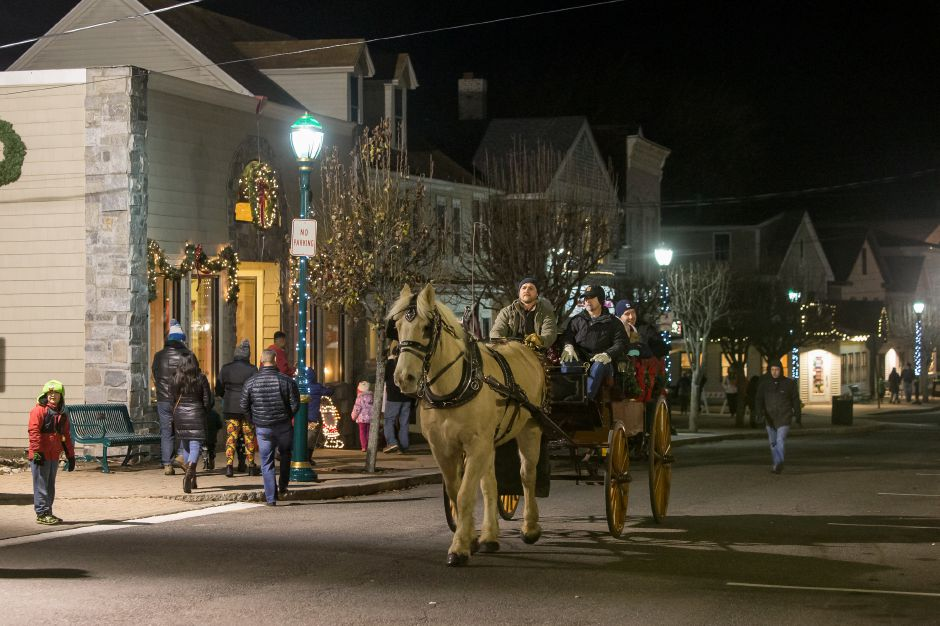 Horse drawn wagon rides from Wood Acres Farm were popular Friday during White Christmas in the Community in downtown Southington December 7, 2018 | Justin Weekes / Special to the Record-Journal