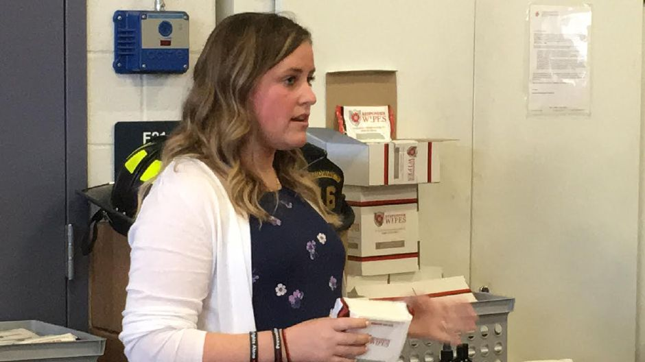 North Haven resident Kristine Munck  raised more than $1,000 to purchase on-scene decontamination wipes. She donated them to the North Haven Fire Department on March 4, 2018. | Lauren Takores, Record-Journal