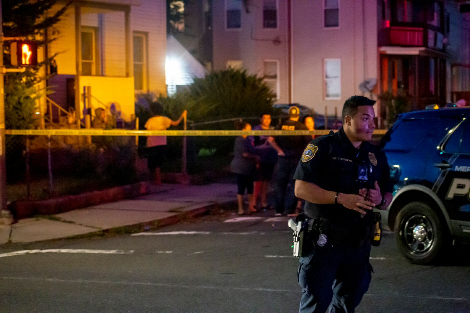 Police speak with neighbors who came out to see what happened after a shooting near the corner of Crown and Olive streets in Meriden Aug. 19, 2020. | Richie Rathsack, Record-Journal