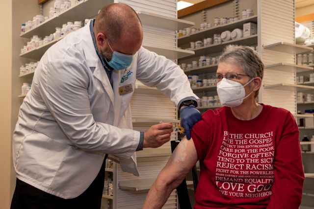 Pharmacist Brian Meyer gives Kay Ketzenberger the first dose of the Moderna COVID-19 vaccine on Tuesday, Jan. 5, 2021 at Sunflower Pharmacy in Odessa, Texas. The Moderna vaccine for the virus does not establish immunity until 7 to 14 days following the second dose according to the CDC. Sunflower Pharmacy is the first privately owned pharmacy in Odessa given to permission to distribute the vaccine. (Eli Hartman/Odessa American via AP)