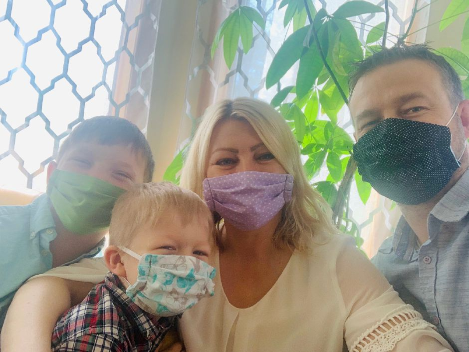 From left to right: Nathaniel, Gabriel, Kasia and John Roginski posing in their home wearing some of the masks they designed for local seniors. Photo courtesy of Kasia Roginska.