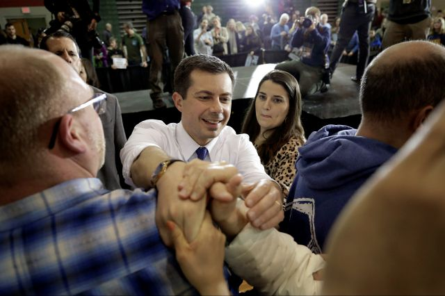 Democratic presidential candidate former South Bend, Ind., Mayor Pete Buttigieg, center, greets people in the audience at the conclusion of a campaign rally on Sunday in Dover, N.H. Steven Senne, Associated Press