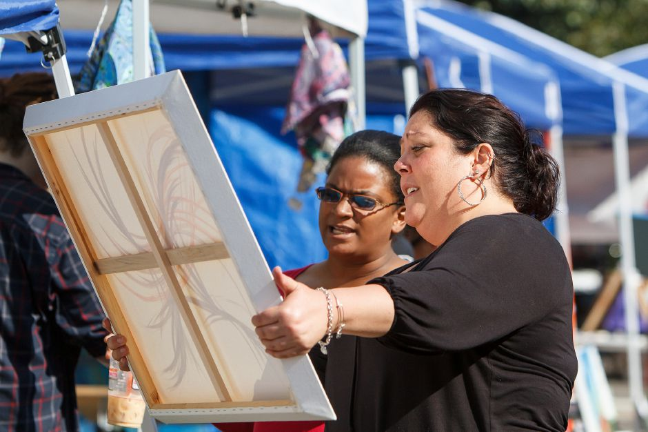 Tanya Leonard of Bristol show an orginal work to Carrie Fisher of New Haven during the Craft Fair at the Southington Apple Harvest Festival in Southington Saturday October,12 2013 | Justin Weekes / For the Record-Journal
