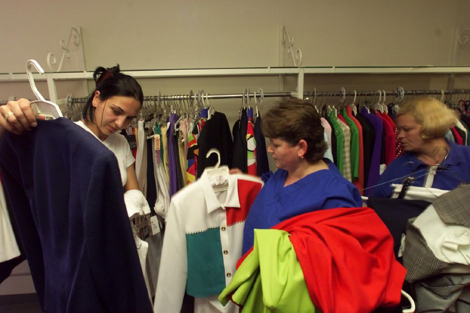 RJ file photo - Jehona Marku, 21, left, shows a jacket to Julie Bojka, of Wallingford, and Jehona