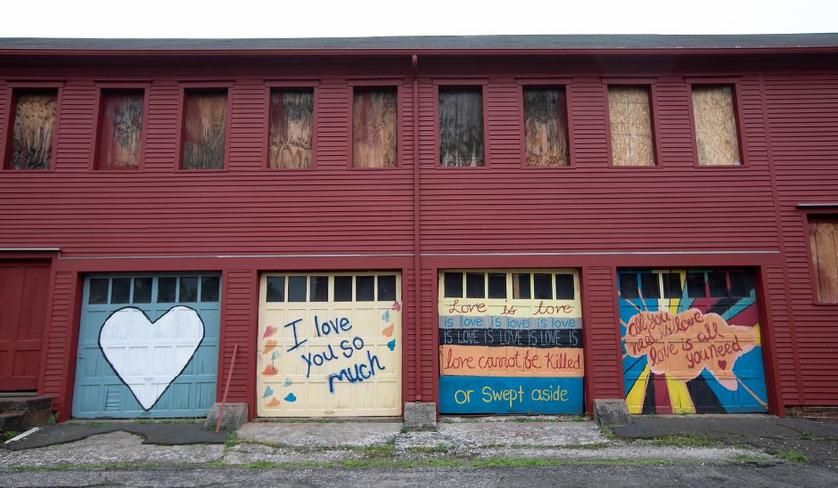 Messages of love painted on the east wing of the Ball & Socket Arts building on West Main Street in Cheshire, Thurs., Jun. 11, 2020. Dave Zajac, Record-Journal