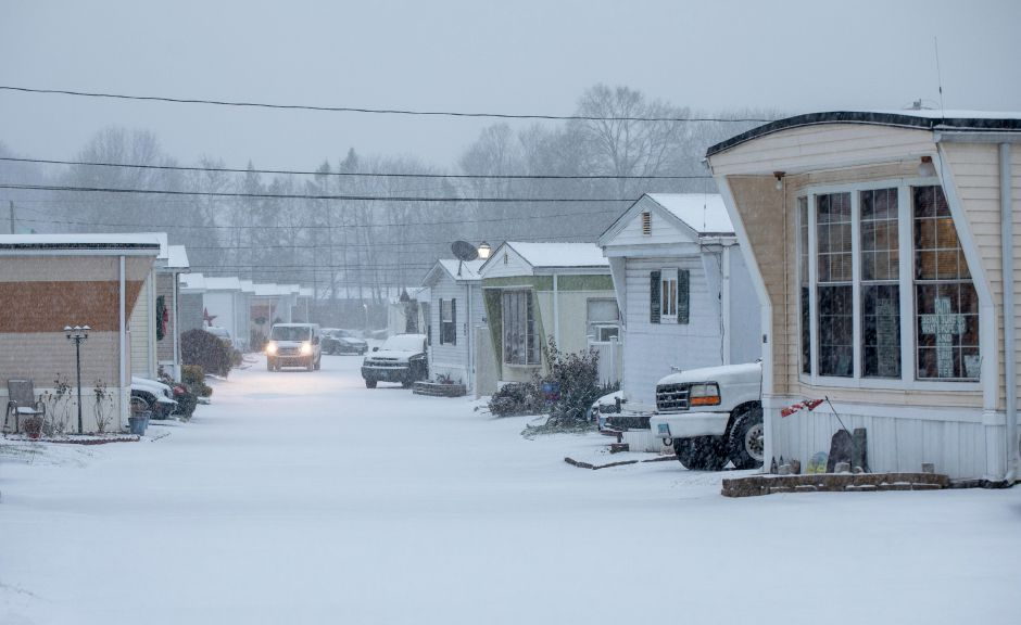 Snow falls at Colony Brooks Homes in Meriden off Gypsy Lane on Dec. 1, 2019. | Devin Leith-Yessian/Record-Journal