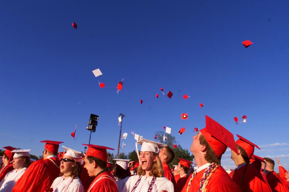 RJ file photo - Graduates from Cheshire High school celebrate with some cap tossing and lots of cheering at the completion of their commencement exercises Monday night June 21, 1999.
