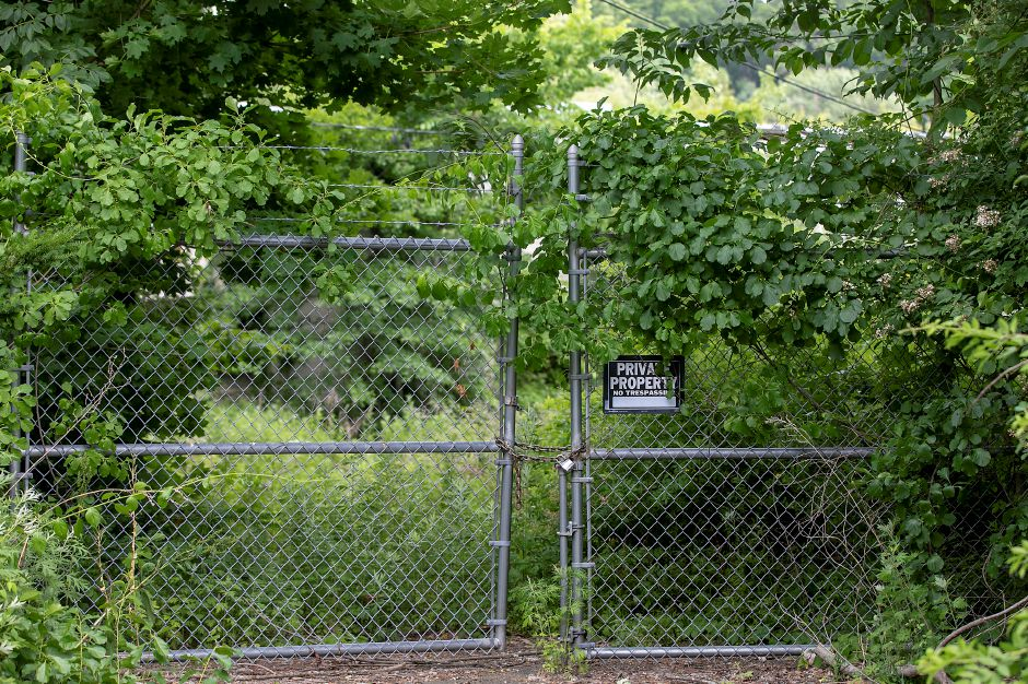 A locked gate at the entrance to the former nursing home off Hazel Drive in Cheshire, Tues., Jun. 23, 2020. A Stratford-based developer is proposing to redevelop the site into a two-building apartment complex with 114 total apartments. Dave Zajac, Record-Journal