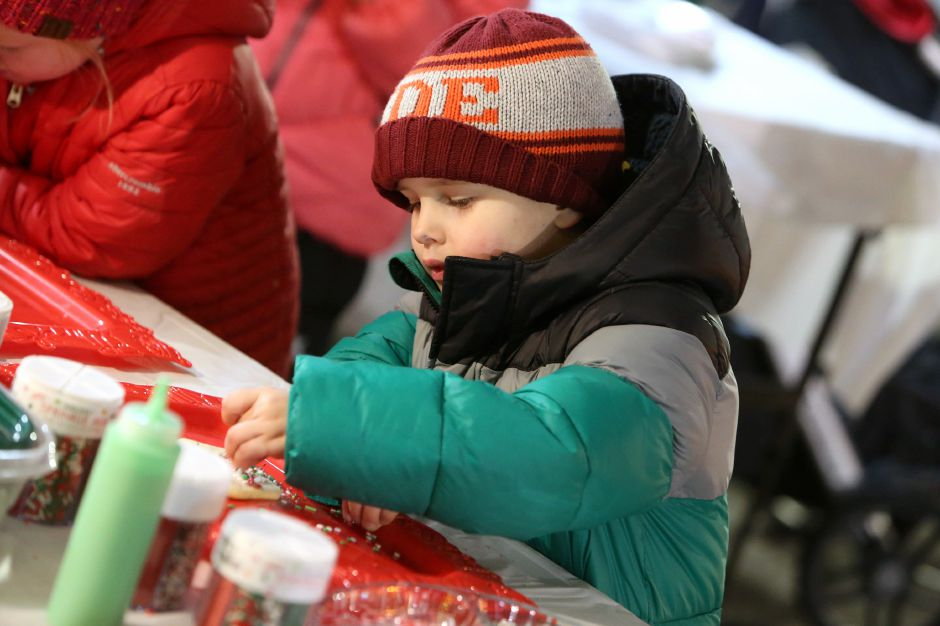 Jack Wroblewski, 4, of Southington, decorates a cookie at The Light Hangar Co. booth during the annual Southington White Christmas in the Community event on Friday night, Dec. 6, 2019. Emily J. Tilley, special to the Record-Journal.